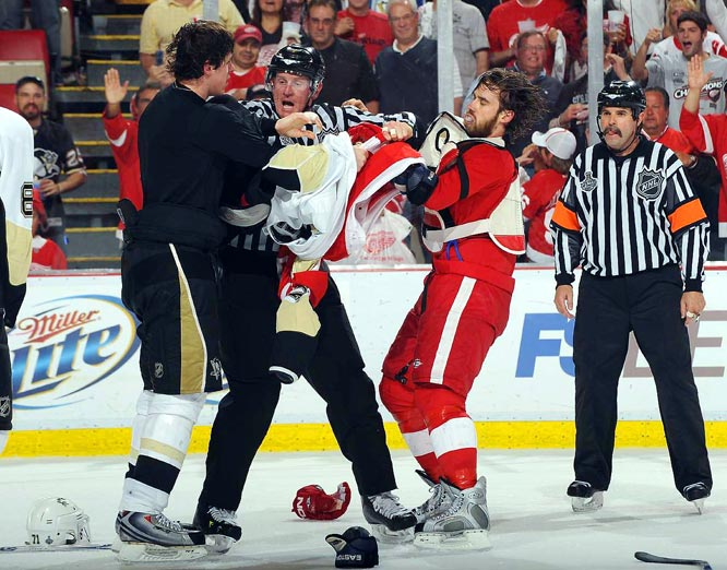 The bad blood between the teams truly started near the end of Game 2, when Evgeni Malkin (left) and Henrik Zetterberg got into a scrum near the Wings' goal.