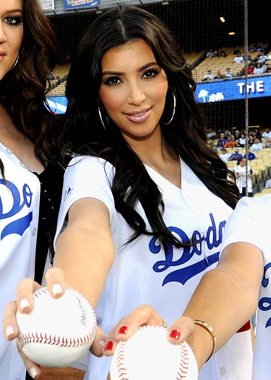 """While Bush was busy flying in San Diego, Kardashian became a good-luck charm for the Dodgers last Wednesday, throwing out the first pitch before L.A. won its 13th straight home game to start the season, a modern-day record. Too bad the good luck ran out the next day as Manny Ramirez was suspended for 50 games and the Dodgers proceeded to lose three of their next four games. At least Kardashian's first pitch wasn't as bad as Gary """"Baba Booey"""" Dell'Abate's wild throw at the Mets' Citi Field on Saturday."""