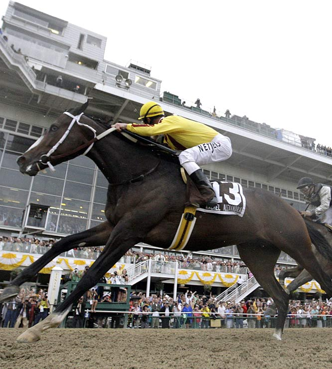 Jockey Calvin Borel gets low as Rachel Alexandra explodes down the left side.