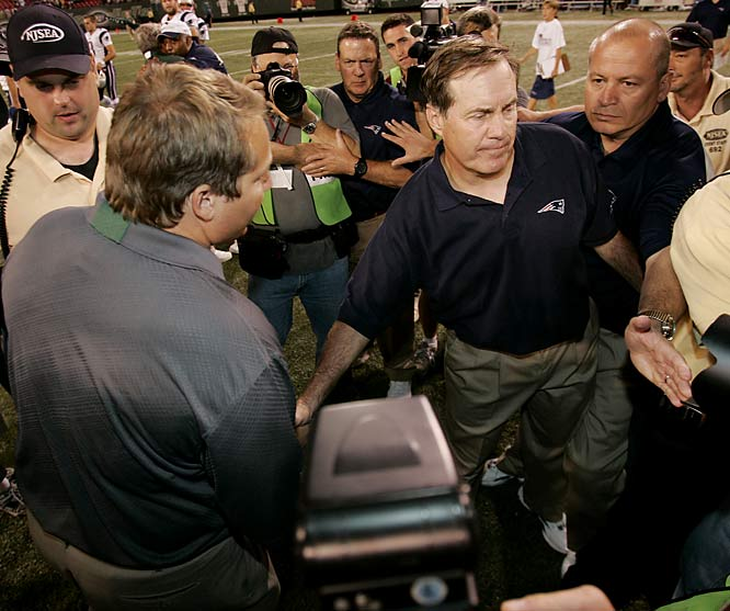It was bad enough that Mangini left Belichick's staff to take over the New York Jets -- a move that earned him a cold handshake following a 2006 game against the Patriots (pictured) -- but things really turned sour when Mangini helped his former boss incur a $500,000 fine and the loss of a first-round draft pick on the heels of Spygate.