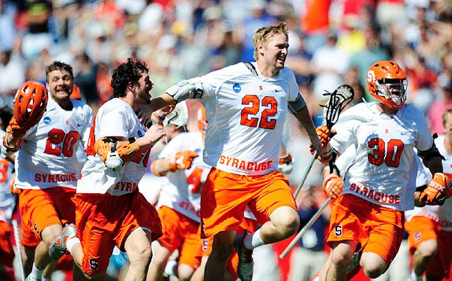 Senior Dan Hardy and his teammates celebrated after Cody Jamieson converted Hardy's assist at the 2:40 mark of the extra session for the game-winner.