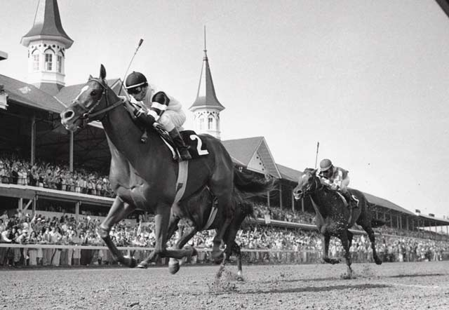 At the 104th Kentucky Derby, Steve Cauthen rides Affirmed to victory in 2:01.2. The horse would go on to win the Triple Crown.