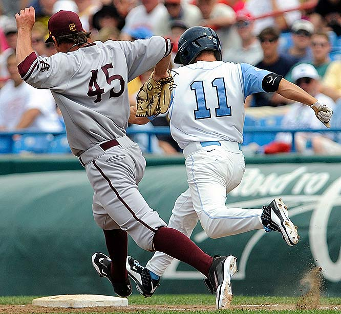 North Carolina's Mike Cavasinni beats Arizona State's Josh Spence to first base for a single in the sixth inning.