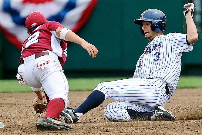 Cal State Fullerton's Josh Fellhauer is caught in an attempted steal of second base by Razorback second baseman Bo Bigham.