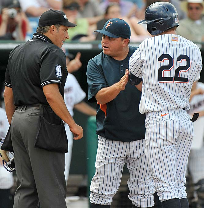 Following is a game-by-game recap of the College World Series. Click the back button to the left of the headline to view the most recent additions. <br><br>Cal State Fullerton coach Dave Serrano, center, argues that Gary Brown (22) was hit by an Arkansas pitch in the eighth inning of the opening game of the CWS.