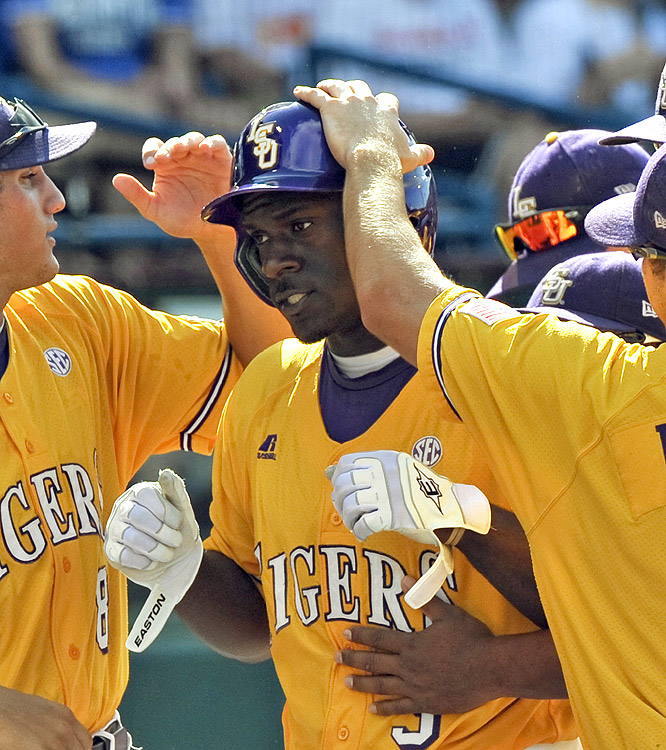 Jared Mitchell is the center of attention after slamming one four home runs for the Tigers, who reached their sixth CWS final.