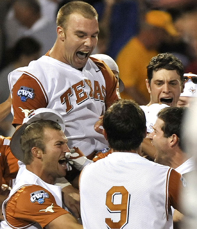 Texas' Connor Rowe (right) celebrates with teammates, including Cameron Rupp (top left) after he hit the game-winning home run in the bottom of the ninth. Rupp, the previous batter, had homered to tie the game.