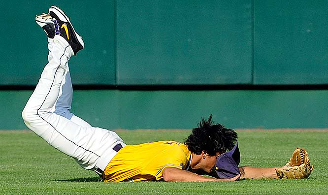 LSU center fielder Mikie Mahtook lands after making a leaping catch in the second inning.