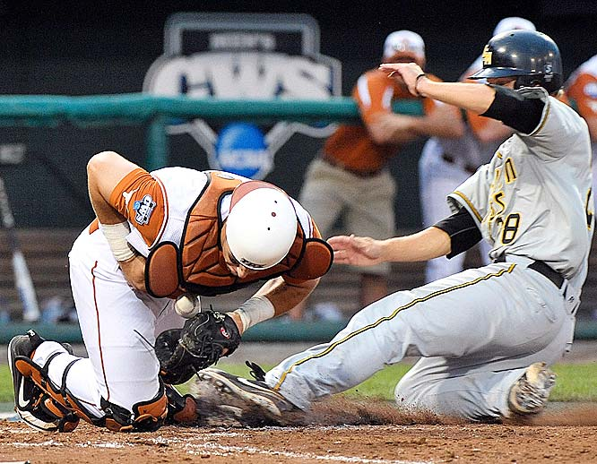 Southern Mississippi's James Ewing scores as Texas catcher Cameron Rupp can't control the ball in the eighth inning.