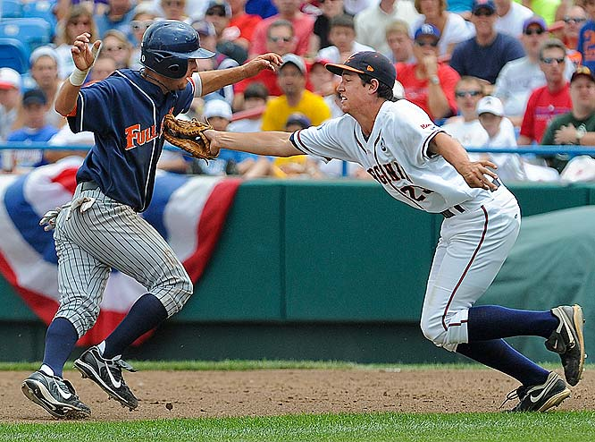 Virginia first baseman Danny Hultzen tags Cal State Fullerton's Josh Fellhauer, who was caught in a rundown between first and second in the third inning.