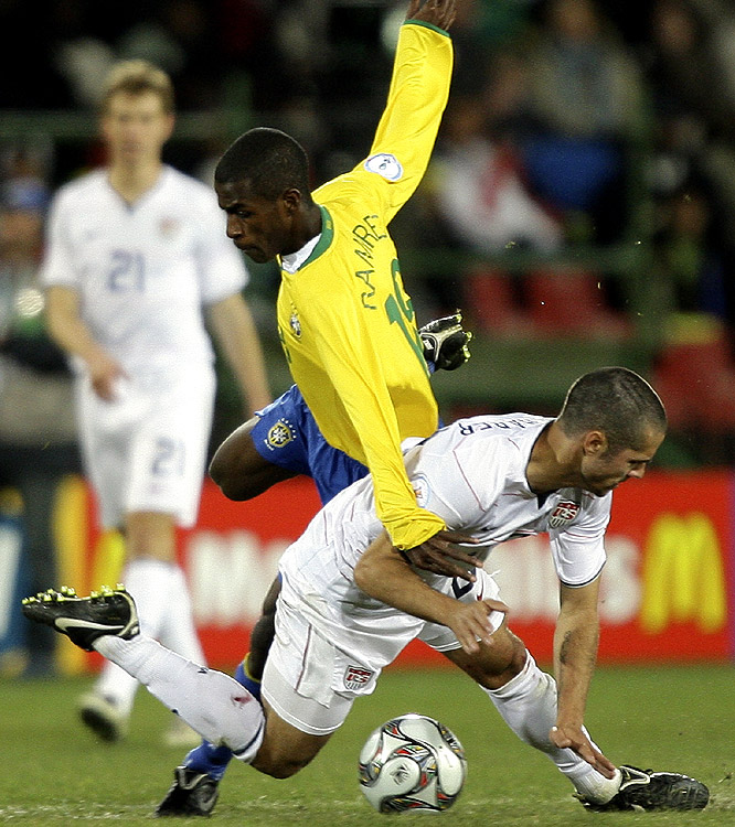 Brazil's Ramires (top) and USA's Benny Feilhaber get acquainted while going for the ball.