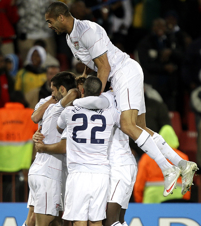 Clint Dempsey (second on left) reacts with his U.S. teammates after scoring just 10 minutes into the match to give the U.S. an early lead.
