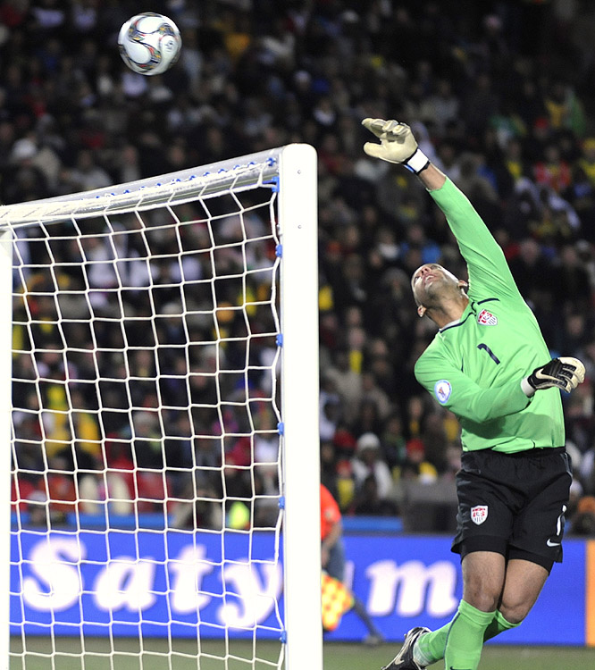 Tim Howard records another difficult save. The U.S. goalie was named goalkeeper of the tournament, despite conceding nine in four outings.