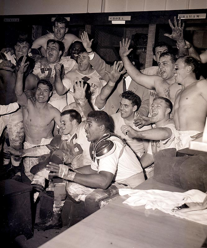 Cleveland Browns QB Otto Graham (bushy hair, center) celebrates with teammates after defeating Detroit in the 1954 NFL Championship.