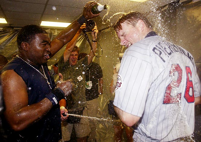 David Ortiz pours champagne over teammate A.J. Pierzynski's head after the Twins defeated Oakland in Game 5 of the AL Division Series.