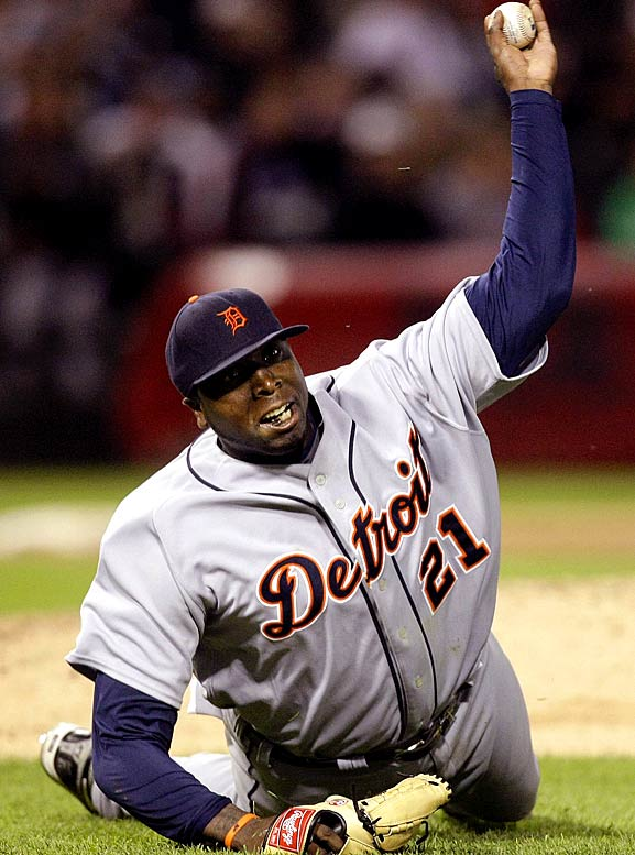 Tigers starting pitcher Dontrelle Willis throws out the White Sox's A.J. Pierzynski at first from the ground during the fifth inning.