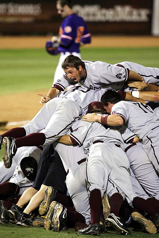 Arizona State pitcher Josh Spence (top) joins the celebration after the Sun Devils beat Clemson, 8-2, in the NCAA super regional. Spence struck out 10 en route to the victory, and Arizona State won the series 2-0, earning its 21st trip to the College World Series.