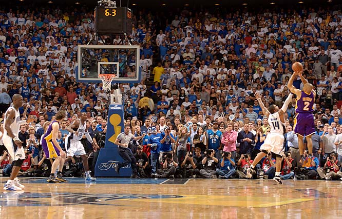 Derek Fisher hits the game-tying 3-pointer over Jameer Nelson with 4.6 seconds in Game 4 of the NBA Finals. The shot forced overtime, where the Lakers went on to beat the Magic 99-91 and take a 3-1 series lead.