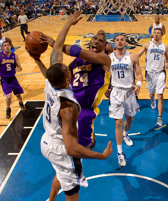 Kobe Bryant drives to the rim against Orlando's Rashard Lewis in Game 5 of the NBA Finals. Bryant scored 30 points and was named Finals MVP as the Lakers defeated the Magic 99-86 to capture the franchise's 15th championship.
