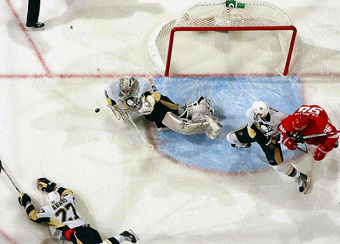 Penguins goalie Andre Fleury saves a last-second shot by Detroit's Nicklas Lidstrom to preserve a 2-1 win and secure the Stanley Cup for Pittsburgh.