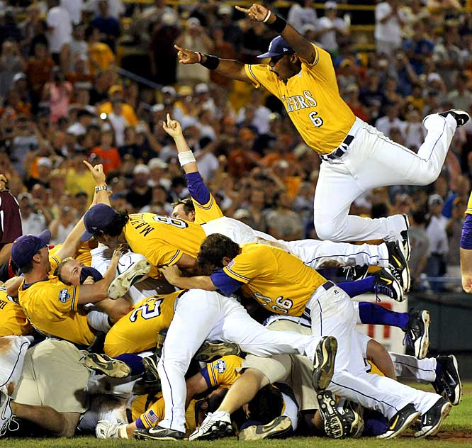 LSU outfielder Leon Landry (6) leaps on top of his teammates after defeating No. 1 seeded Texas 11-4 in deciding game of the NCAA College World Series. LSU earned its sixth national title in Game 3 of the best-of-three national championship series, its first since 2000.