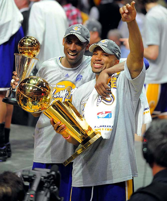 Bryant and Fisher enjoyed a moment with the Finals MVP and the Larry O'Brien trophies.
