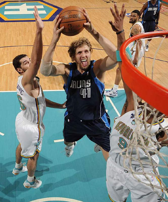 In a prearranged draft-night trade that turned into one of the most lopsided deals in history, the Mavericks sent No. 6 pick Robert Traylor to the Bucks for Nowitzki and rookie Pat Garrity, whom Dallas dealt to Phoenix for Steve Nash. Nowitzki's three-point shooting as a 7-footer transformed the NBA's view of the power forward position. He led the Mavericks to the 2006 NBA Finals and was named league MVP a year later.