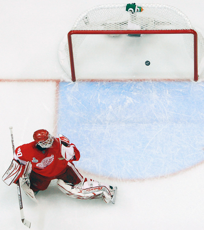 Red Wings goalie Chris Osgood helplessly watches Maxime Talbot's shot sail into net, giving the Penguins an insurmountable 2-0 lead and serving as Talbot's second goal of Game 7.