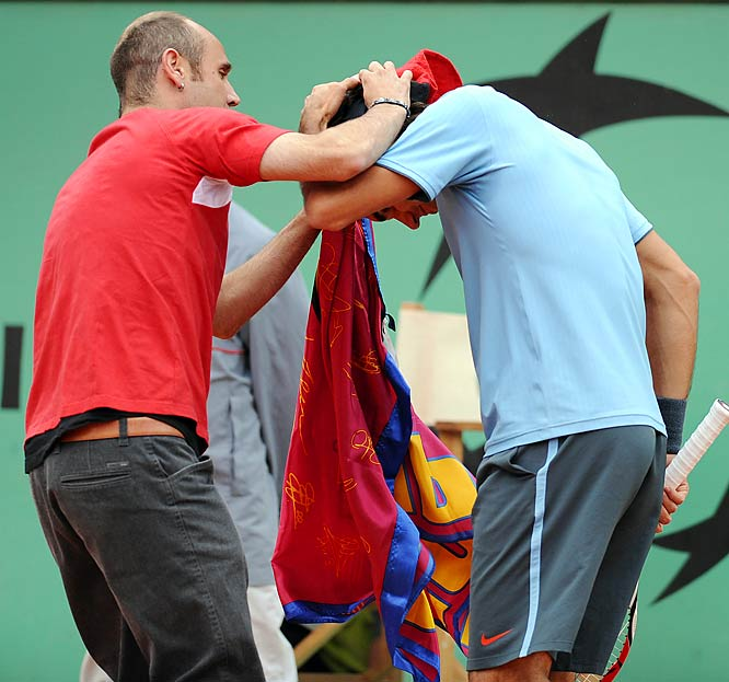 Federer certainly had a better Sunday than security at the French Open. Jimmy Jump, who has made a career out of trespassing onto the fields of various sporting events, got to spend more than 10 seconds with Federer while the No. 2-ranked player was rolling to his record-tying 14th Grand Slam title and first championship at Roland Garros.