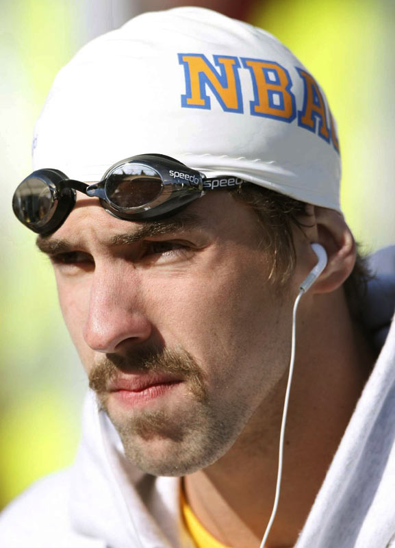 "Taking another page from Mark Spitz, Phelps has grown the most popular facial hair in swimming since Spitz's famous mustache. Some have already labeled it the ""Splash 'Stache."" We can only hope that it becomes a Phelps signature look now."
