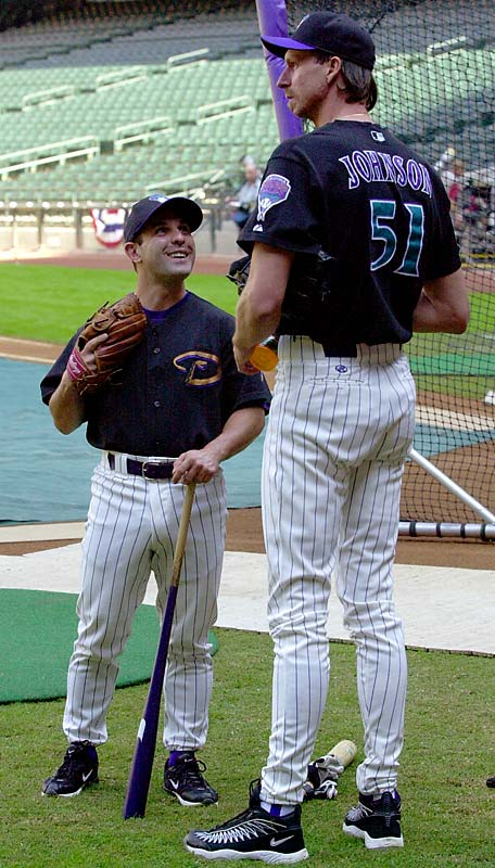 Johnson was a big hit in Arizona, especially standing next to Arizona's batting practice pitcher Tony Dello.