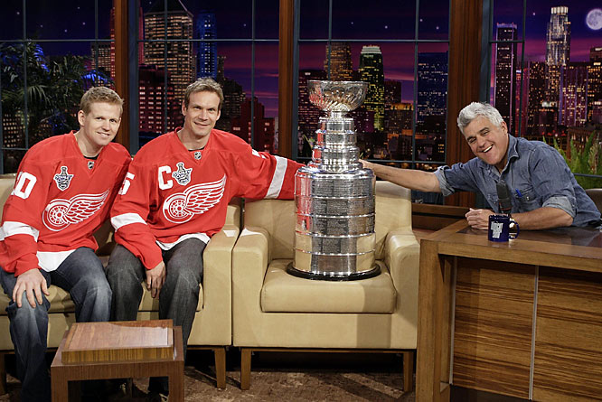 "Detroit's Chris Osgood and Nicklas Lidstrom and host Jay Leno are shown with the Stanley Cup trophy prior to a taping of ""The Tonight Show with Jay Leno"" last June."