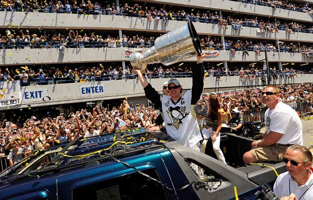 Sidney Crosby holds the Stanley Cup aloft for the fans along the Boulevard of the Allies in Pittsburgh during the Penguins championship parade earlier this week.