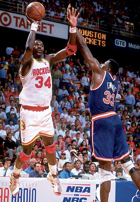 Led by Hakeem Olajuwon's 25 points, 10 rebounds and seven assists, Houston defeats New York, 90-84, in Game 7 of the NBA Finals at The Summit. The win gives the Rockets their first NBA Championship in the 27-year history of the franchise.