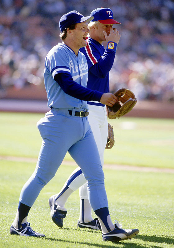 George Brett and Buddy Bell exchange a laugh before the game.