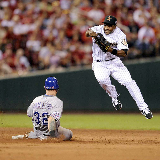 Houston's Miguel Tejada completes a double-play that retired Rangers Josh Hamilton and Michael Young.