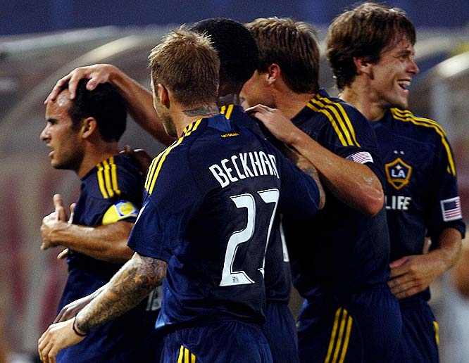 Becks celebrates with teammates following a Landon Donovan goal.