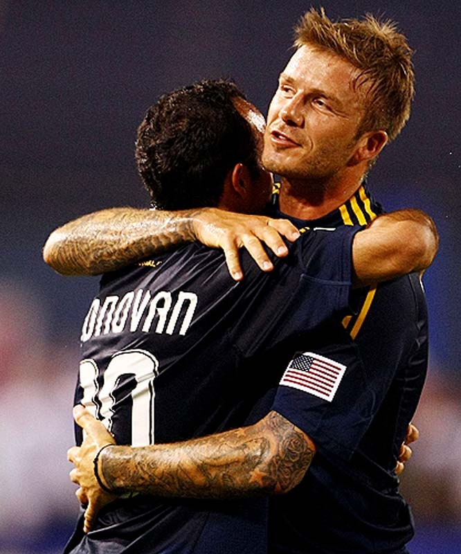Beckham congratulates Landon Donovan, who had been one of his biggest critics, after Donovan's goal.