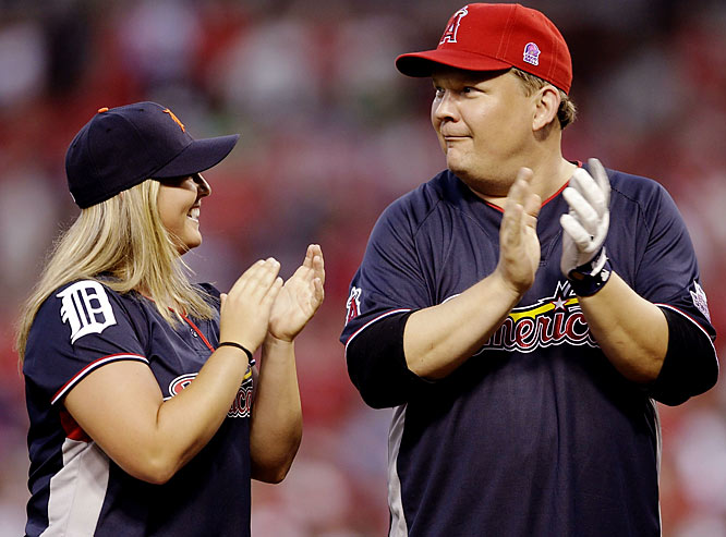 Softball player Kristen Butler claps alongside comedian/actor Andy Richter.