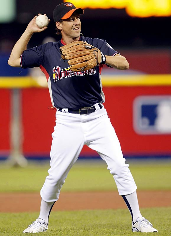 Desperate Housewives star James Denton throws the ball while on defense for the American League team.