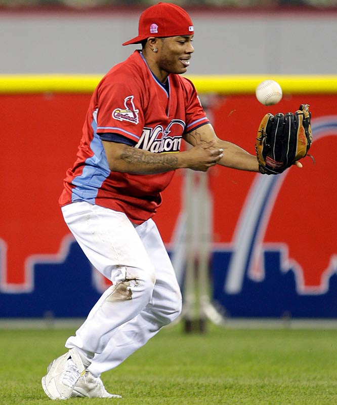 Nelly, the standout performer of the game, plays solid defense for the National League team.