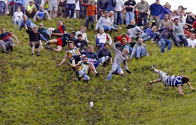 The Annual Cheese Rolling at Cooper's Hill is held on England's Spring Bank Holiday Monday, with contestants hurling (so to speak) themselves down a steep slope in pursuit an 8-pound Double Gloucester. The first contestant to reach the bottom wins the cheese and lasting admiration.