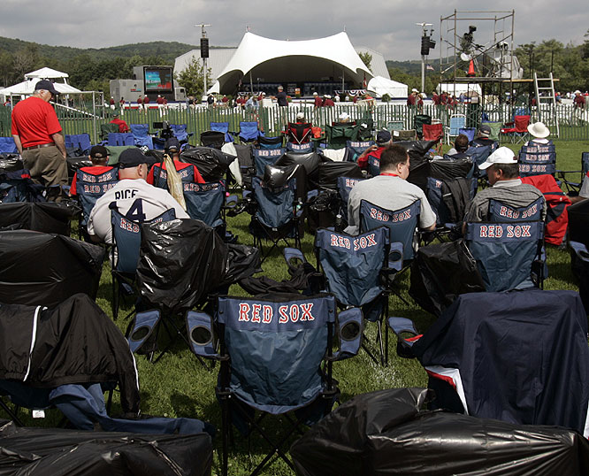 Boston Red Sox fans wait for the start of the Baseball Hall of Fame induction ceremony in Cooperstown, N.Y.