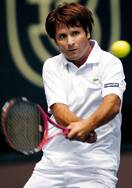 """Nicknamed """"The Magician"""" by Pete Sampras, Santoro has long been a shot-making wizard, playing with both hands on his forehand and backhand. The 36-year-old Frenchman is the oldest active singles player on the ATP tour. He has won 24 doubles titles and six singles titles."""