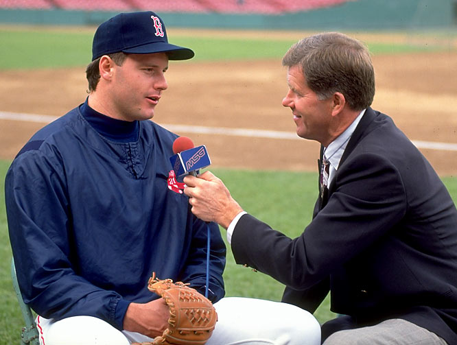 Roger Clemens speaks to a reporter before a game against the Yankees.