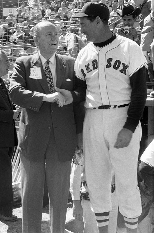 Ted Williams shakes hands with Ty Cobb prior to a spring training game.
