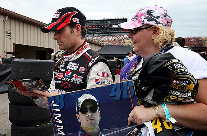 Jeff Gordon inks an autograph for a lucky fan before the Pocono 500.