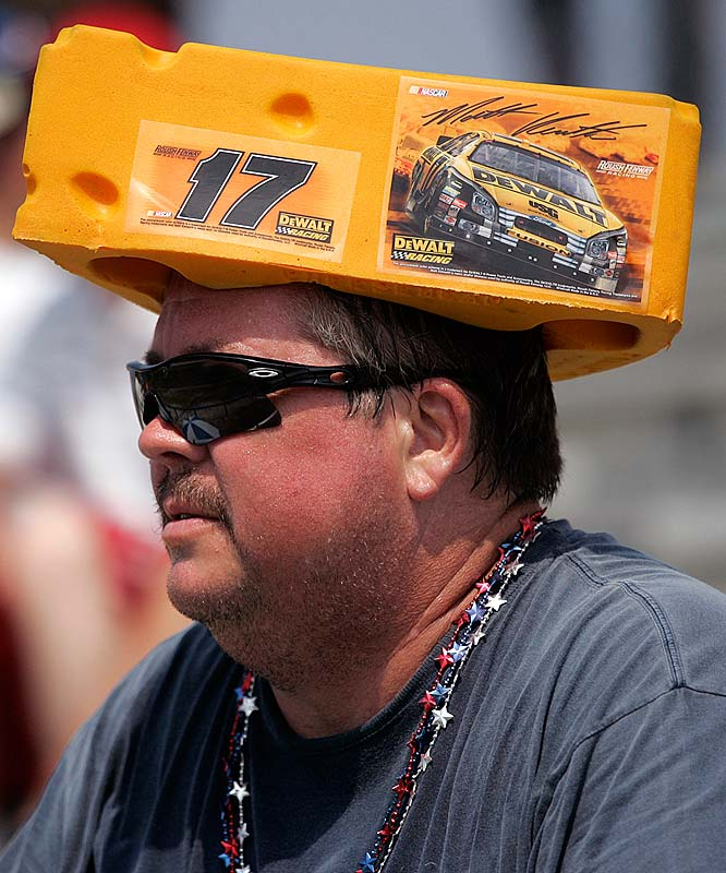 Wisconsin pride: a Matt Kenseth fan and fellow Wisconsin native, wears a cheeshead hat while watching a sports car race prior to the Coke Zero 400.