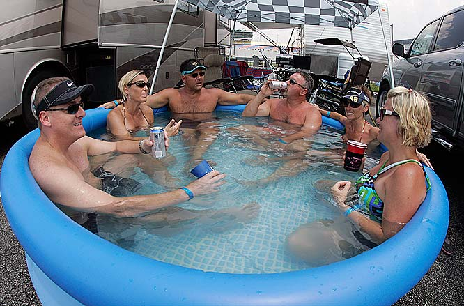 Race fans cool off in a pool before the start of the Coke Zero 400.