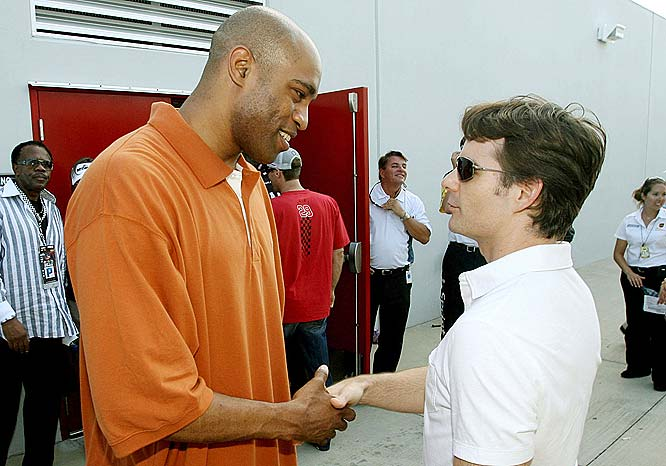 Vince Carter shakes hands with Jeff Gordon before a race.